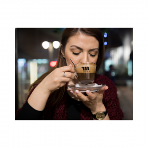 The satisfaction you get when coffee is perfectly roasted into the 'Sweet Spot'. A lady sipping a perfectly extracted espresso. She's in her own world. Loving it!