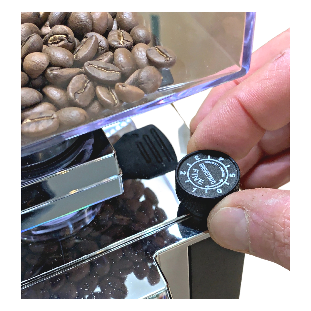 Showing the adjusting knob on a grinder.